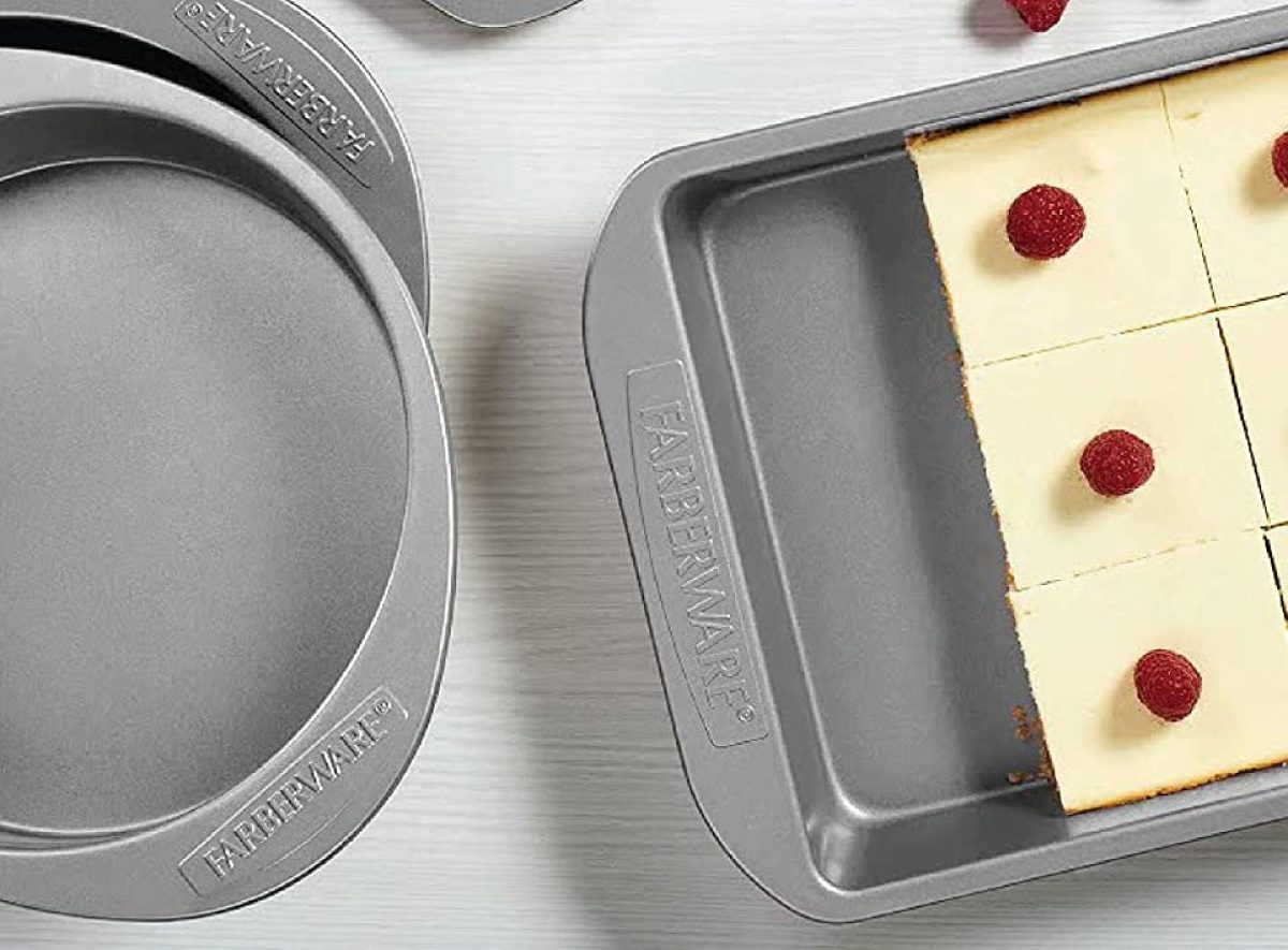 two pans and one has cheesecake in it