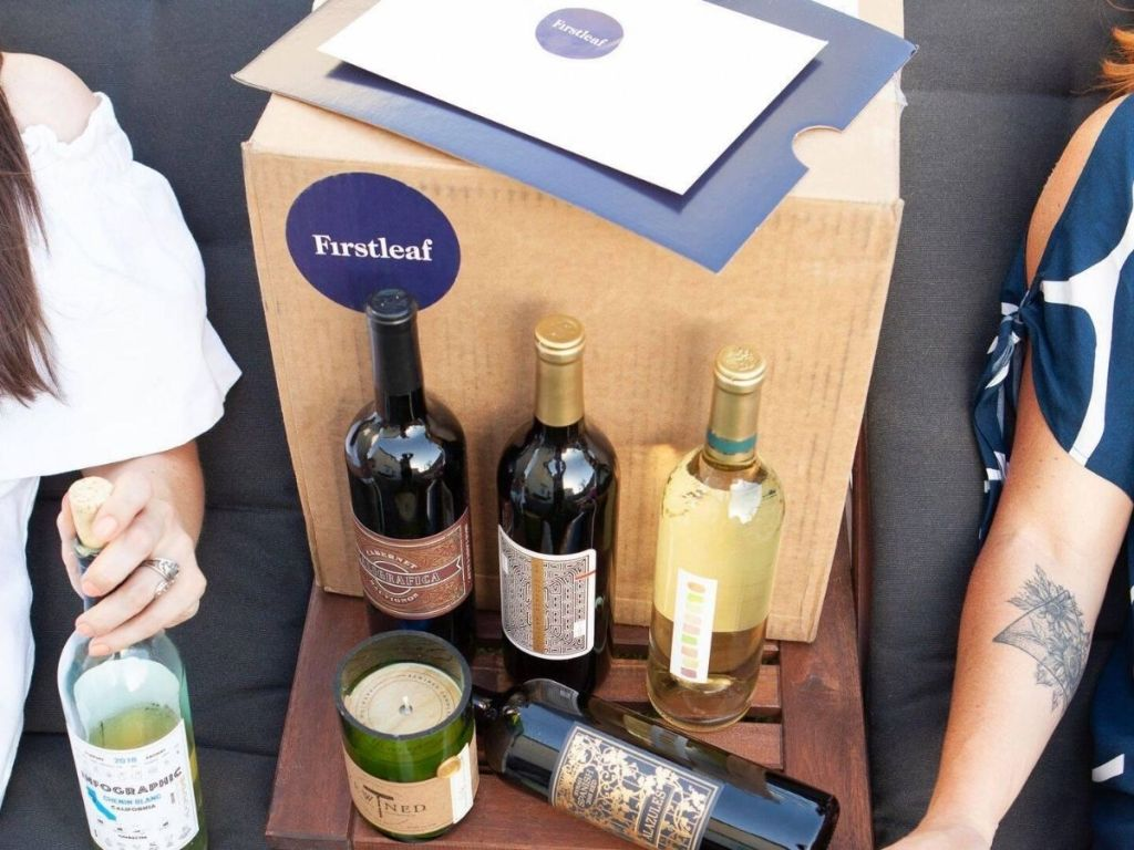 two women with box of wine delivered fromwine subscription club between them