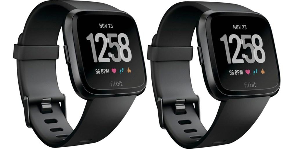 two black fitbit versa smartwatches