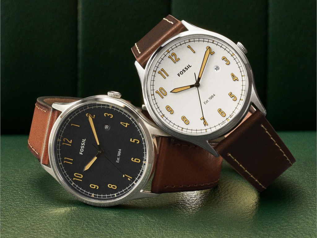 two brown leather men's watches on green table