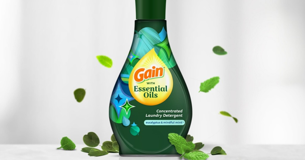 gain laundry detergent surrounded by leaves
