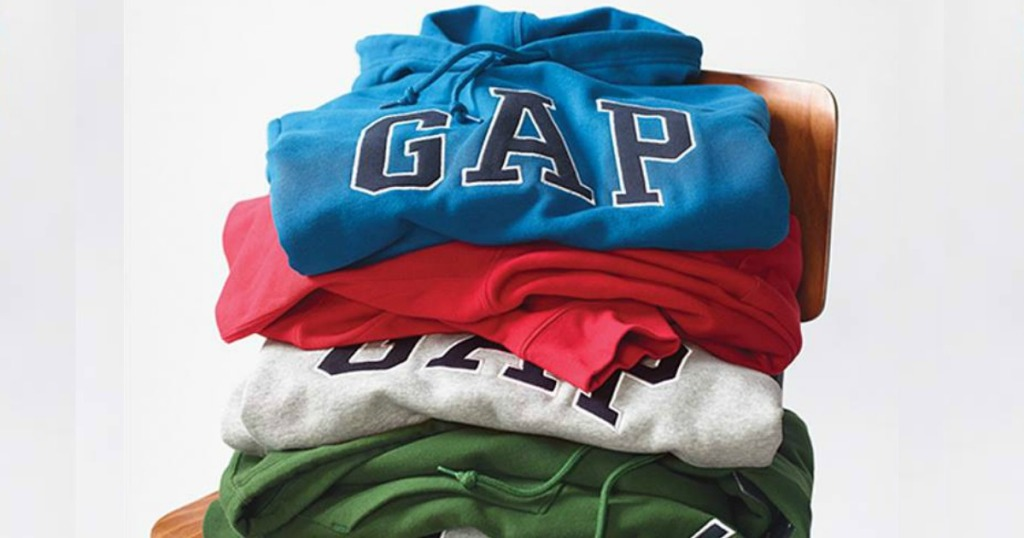 pile of GAP sweatshirts on a chair
