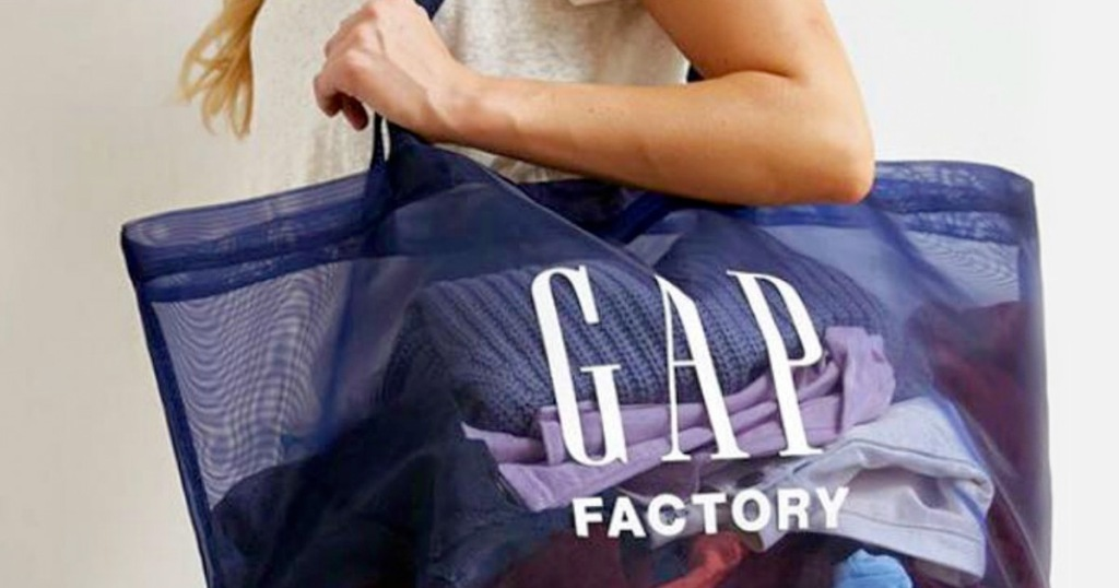 woman with blue mesh gap factory shopping bag on her shoulder