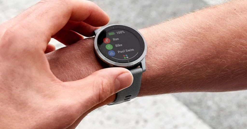 Man programming his Garmin Vivoactive 4 Smartwatch
