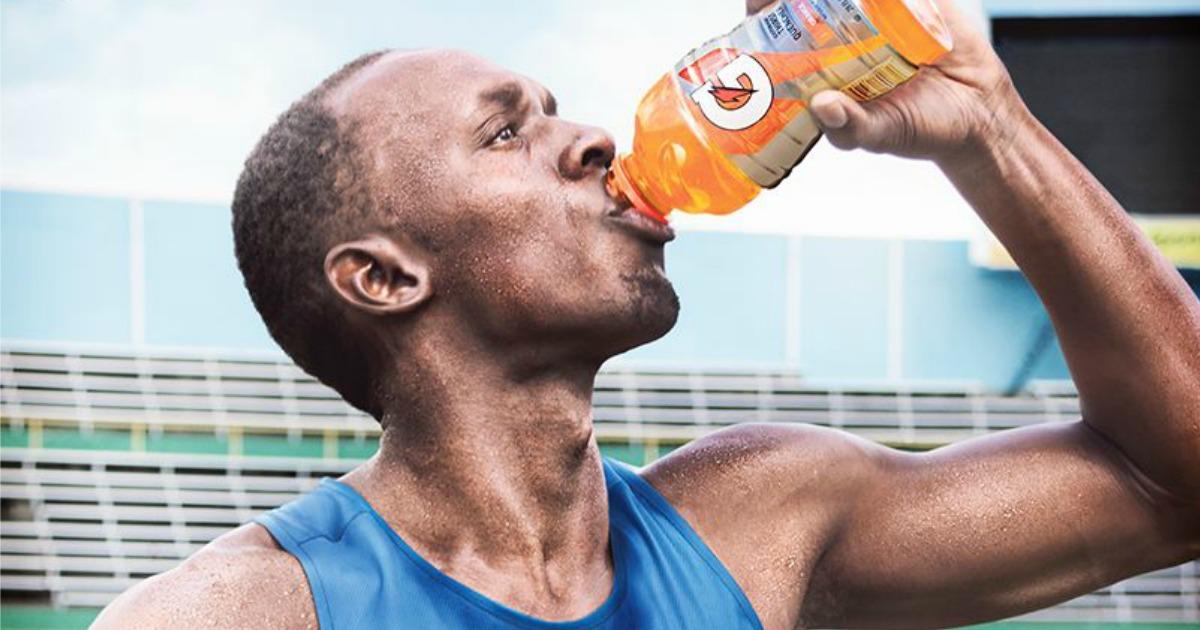 man drinking gatorade