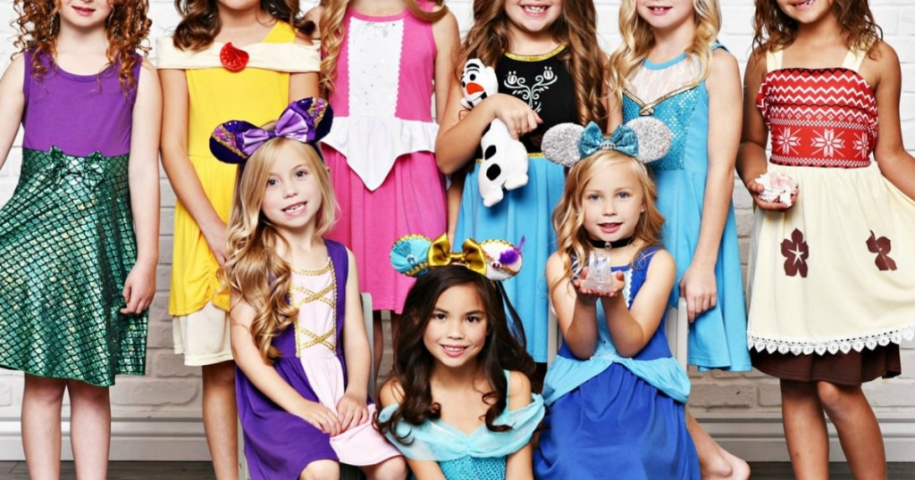 A large group of young girls wearing Disney princess themed dresses