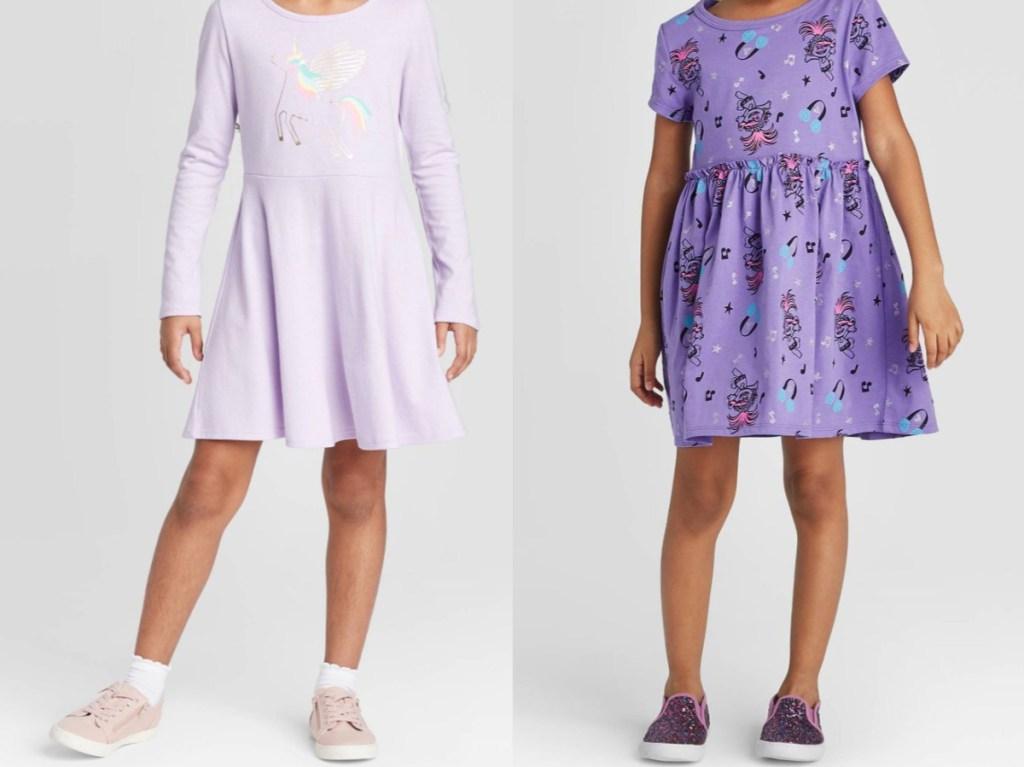 girl in lilac unicorn dress and purple troll dress