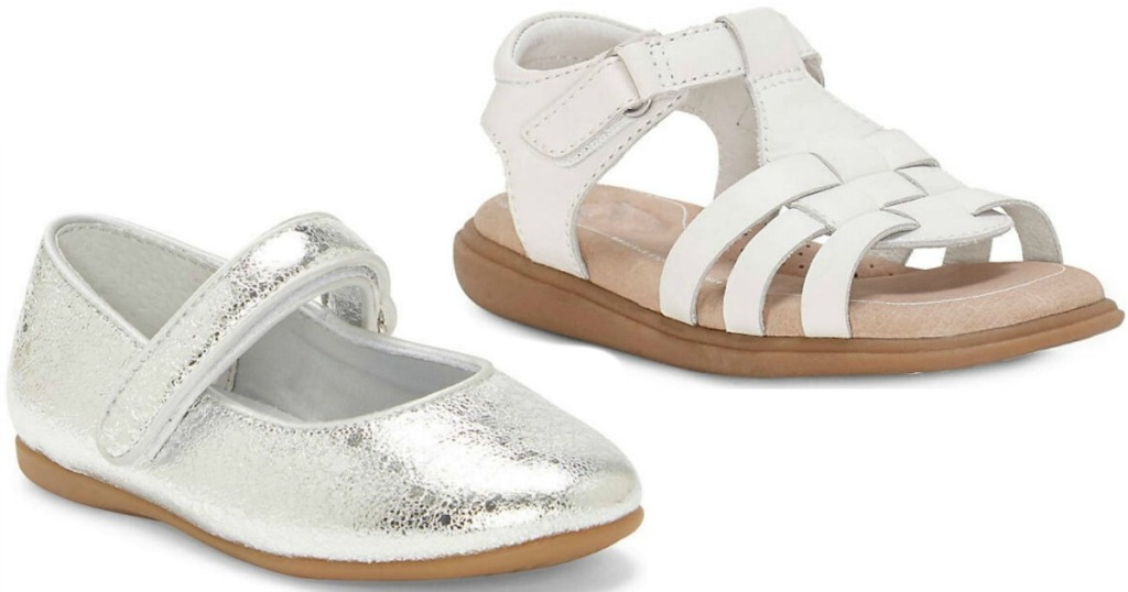 Pair of white girls sandals and silver ballet flats sitting next to each other