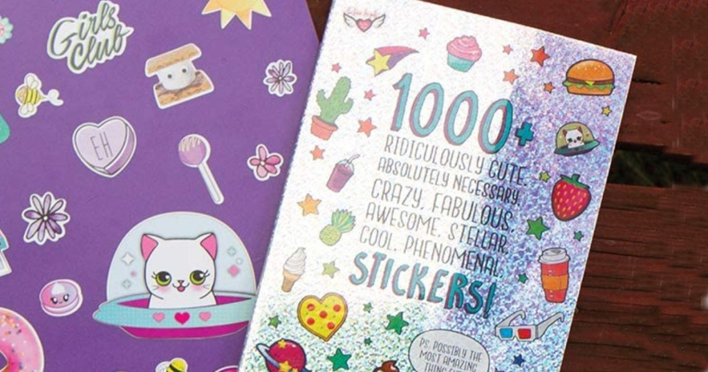 glitter sticker book sitting on a purple folders with stickers