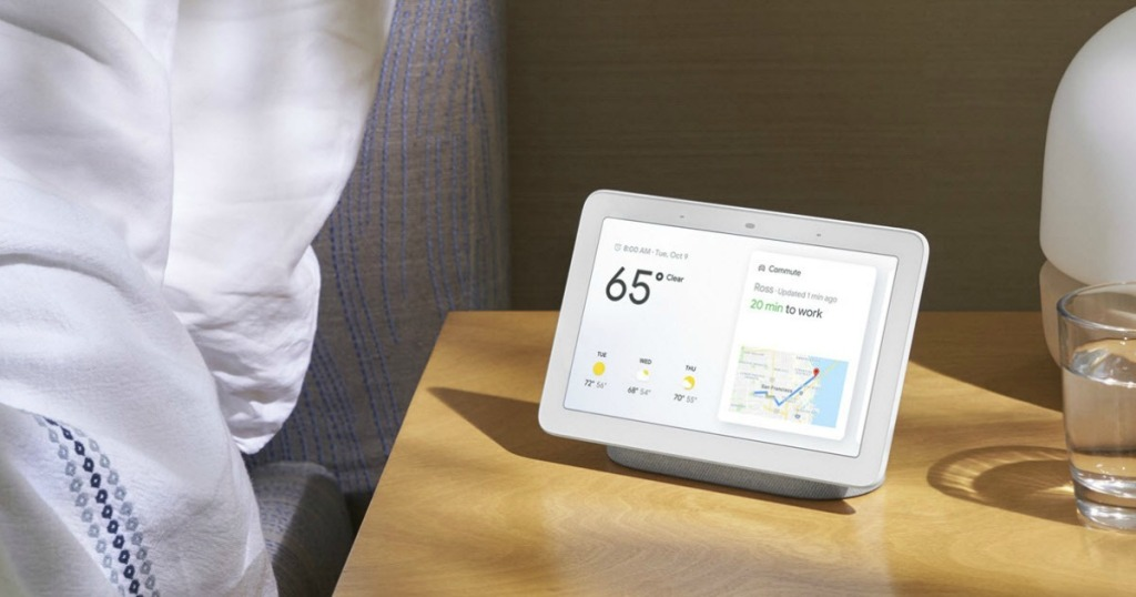 google nest hub display on nightstand by bed