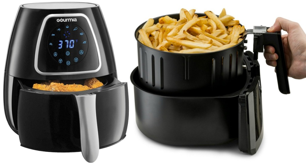 black air fryer with digital display and hand holding up air fryer basket with fries inside