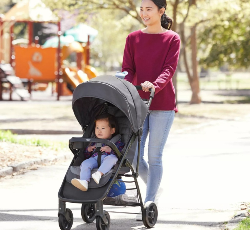 woman pushing a baby in a stroller