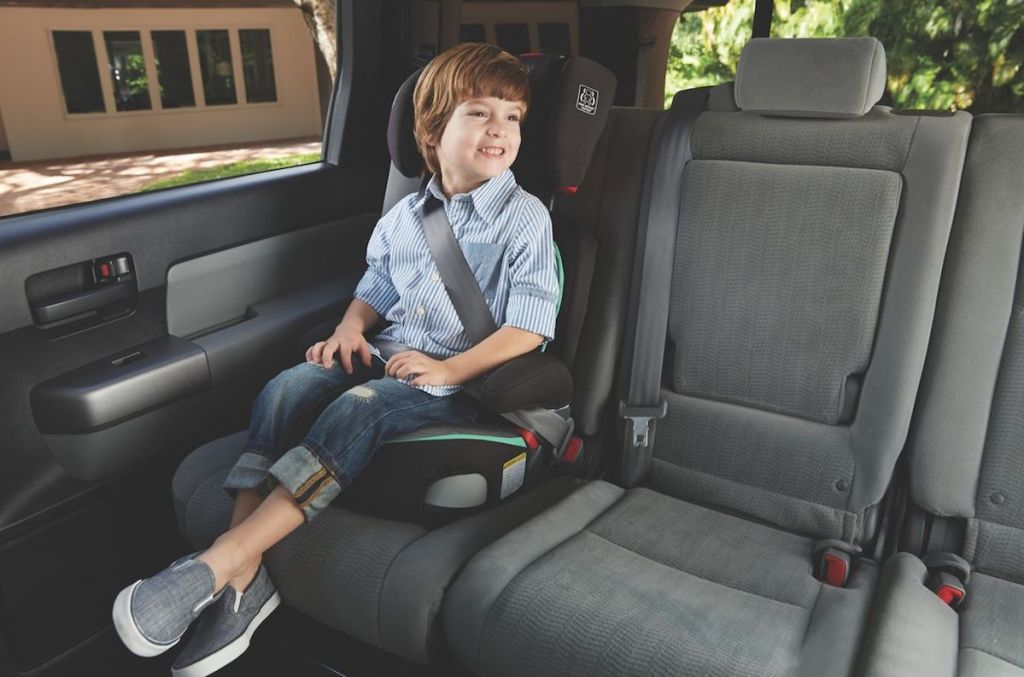 boy sitting in a carseat