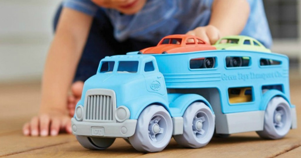 boy playing with Green Toys Car Carrier