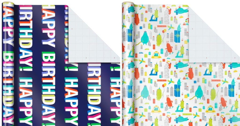 hallmark wrapping paper with navy background with happy birthday writing and also white with monsters