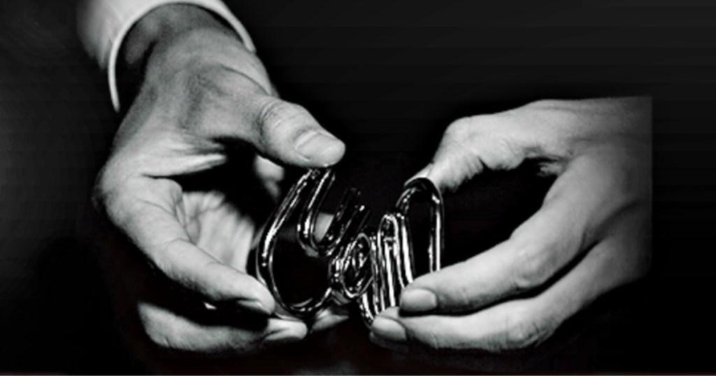 Hanayama Puzzle in person's hands