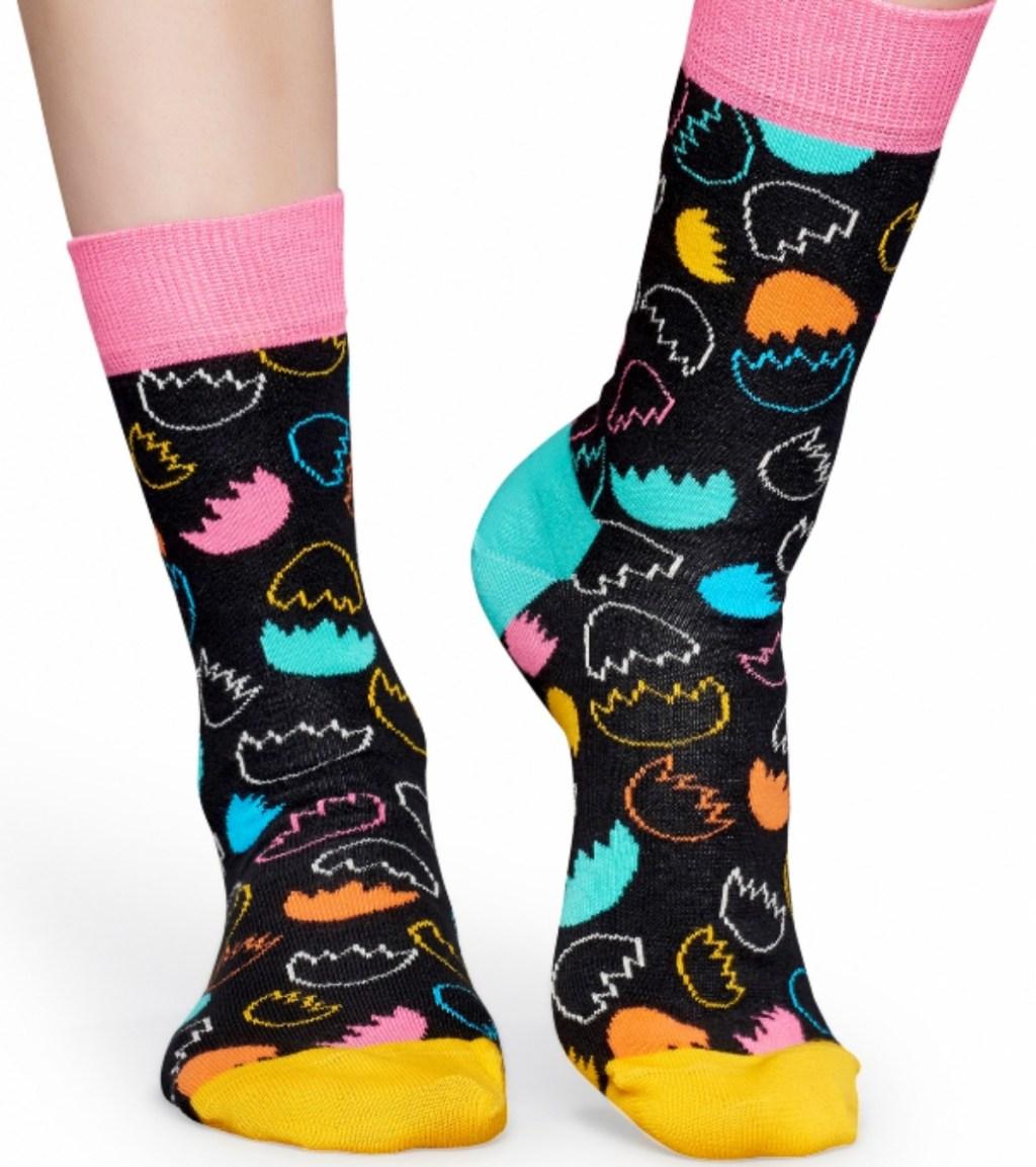 woman wearing colorful egg print socks