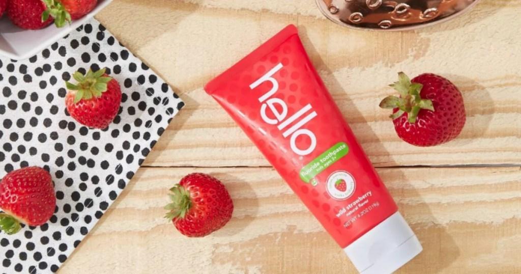 Hello Kids Strawberry Toothpaste on counter next to strawberries