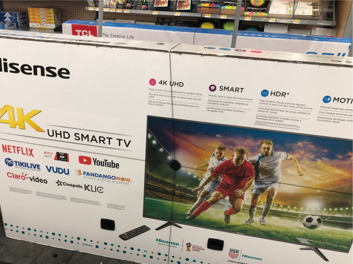 huge tv box on floor in store aisle