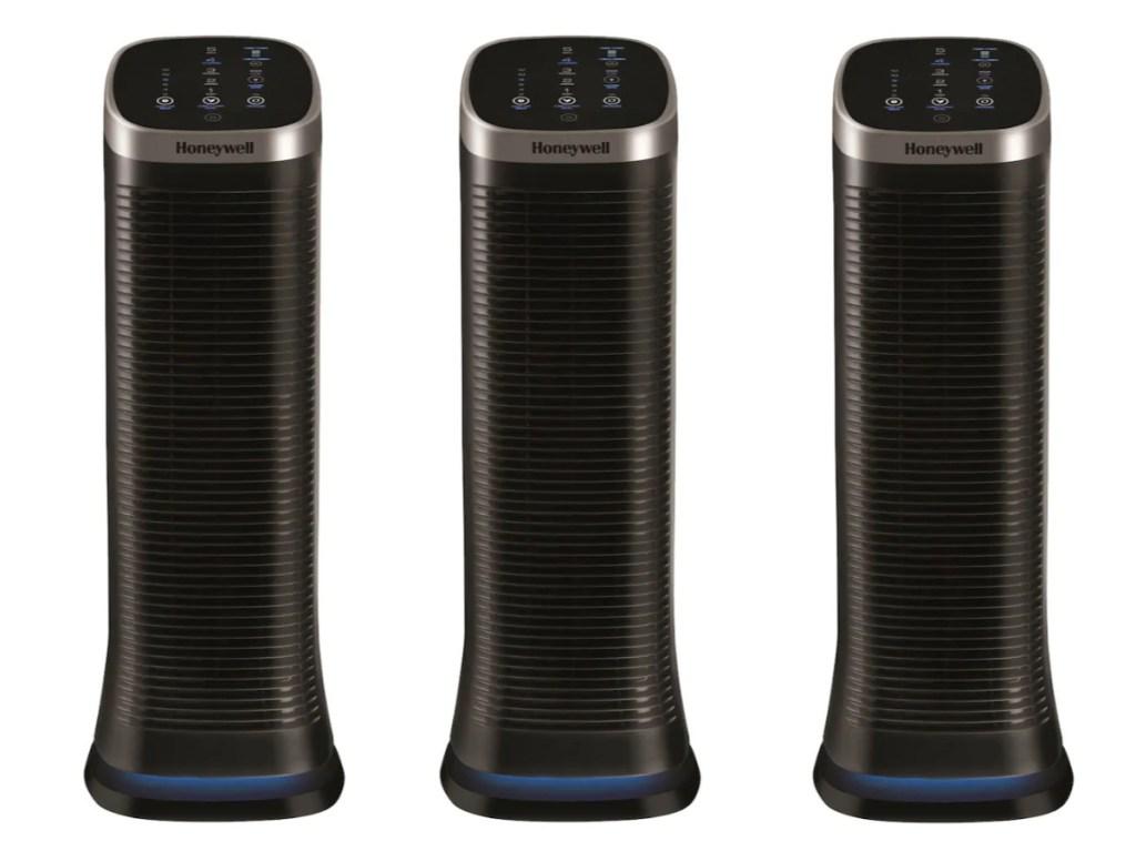 three black air purifiers