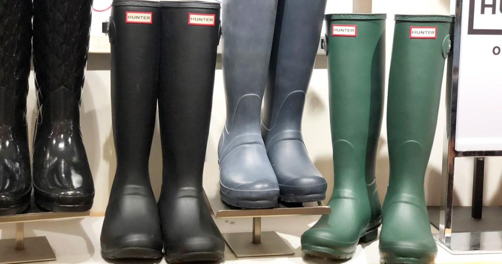 shelf display of various matte finish hunter brand rain boots