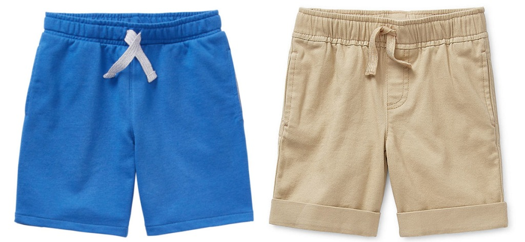 two pairs of boys shorts, one blue and one khaki colored