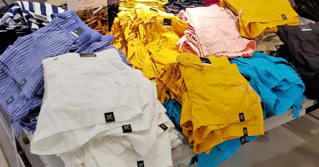 store display table with multiple pairs of womens shorts in different colors