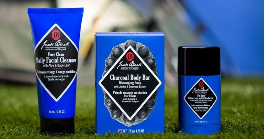 men's skin care products on grass - face wash, body bar and deodorant