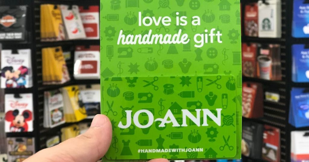 Woman's hand holding a gift card