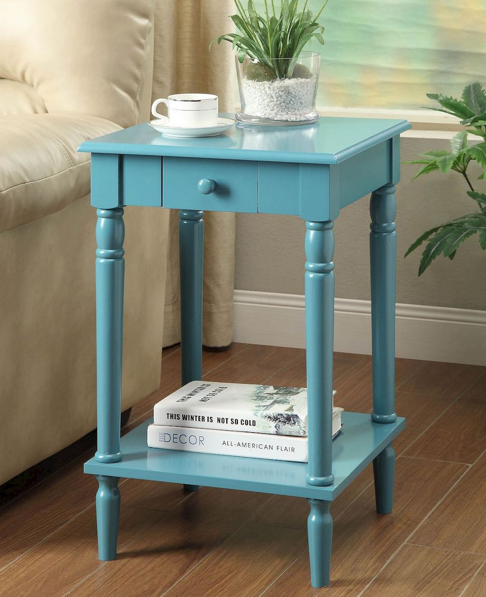 accent table with coffee and plant on top