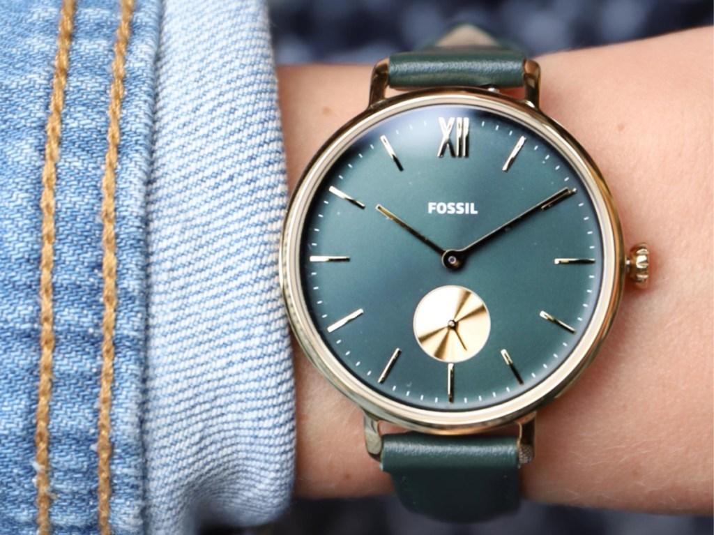 woman's green watch on wrist