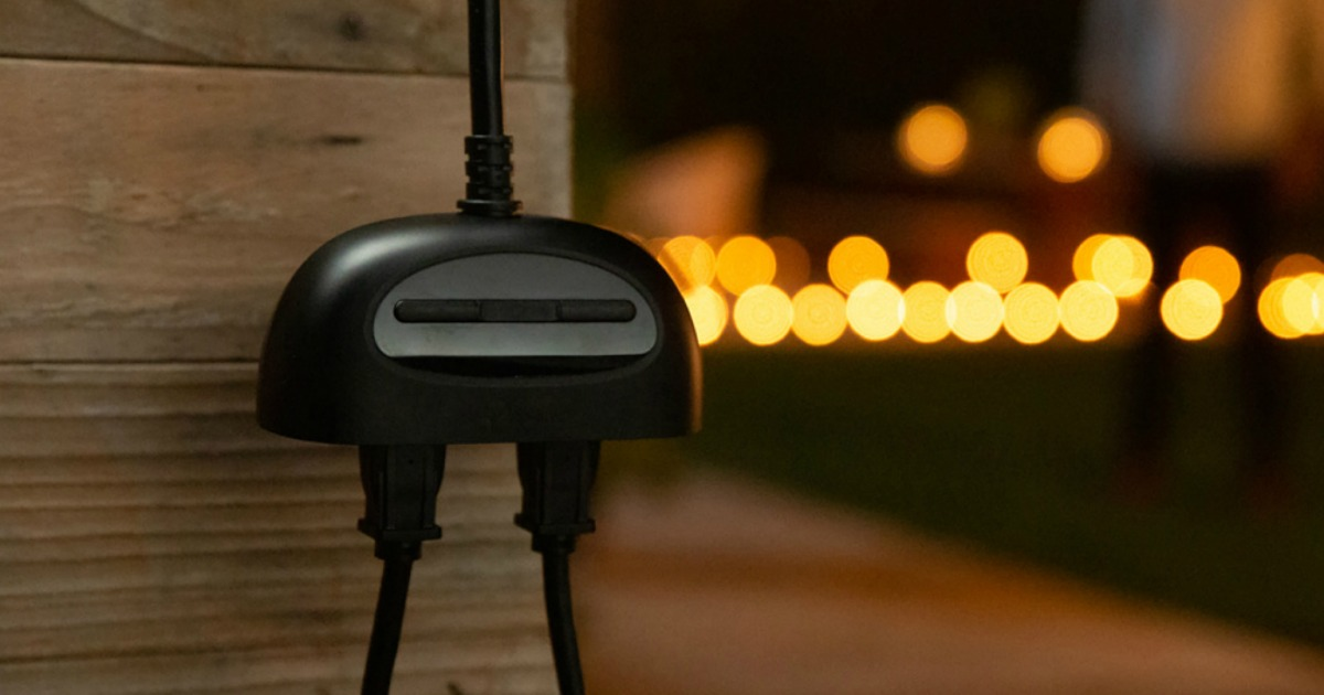 outdoor smart plug next to house with lights in background