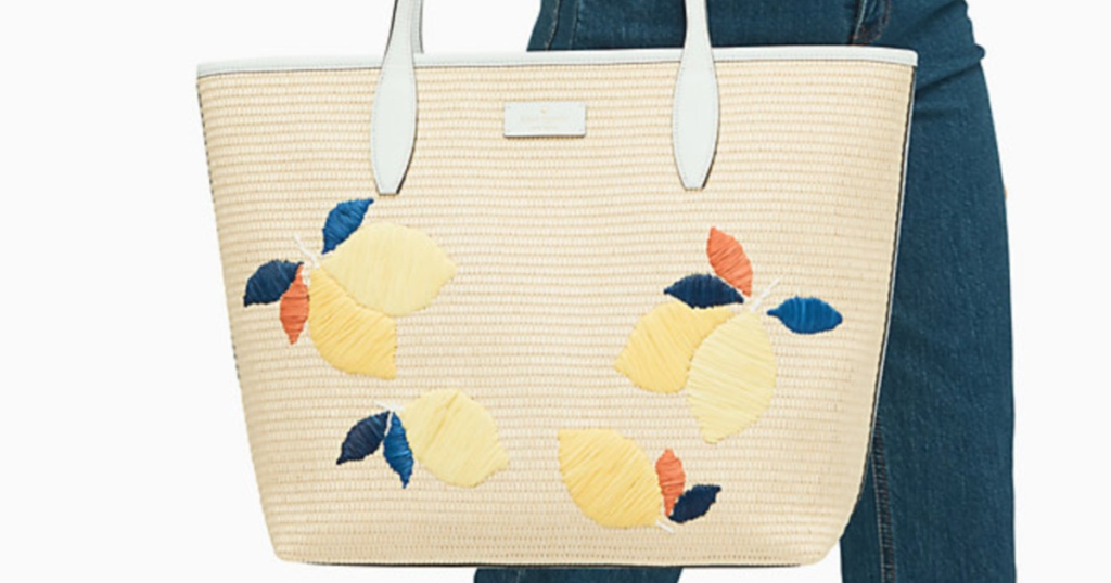 woman holding tote