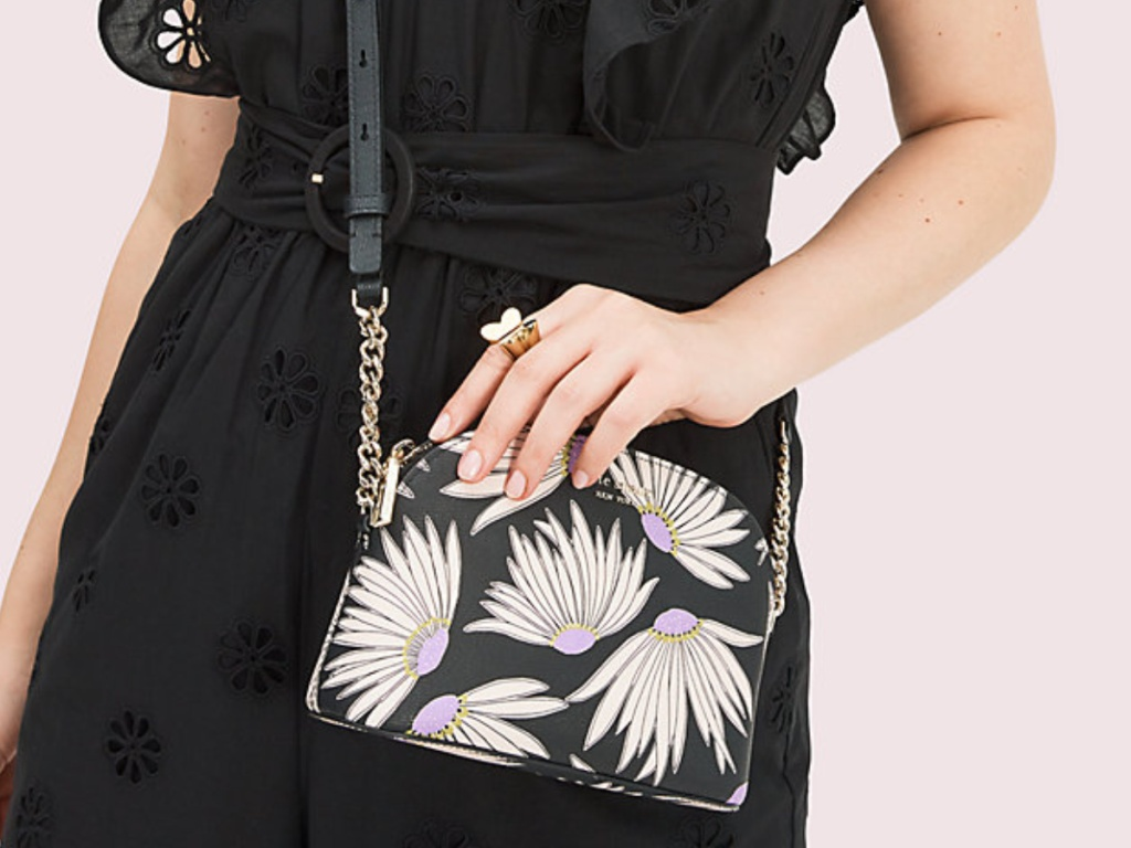 woman carrying floral bag