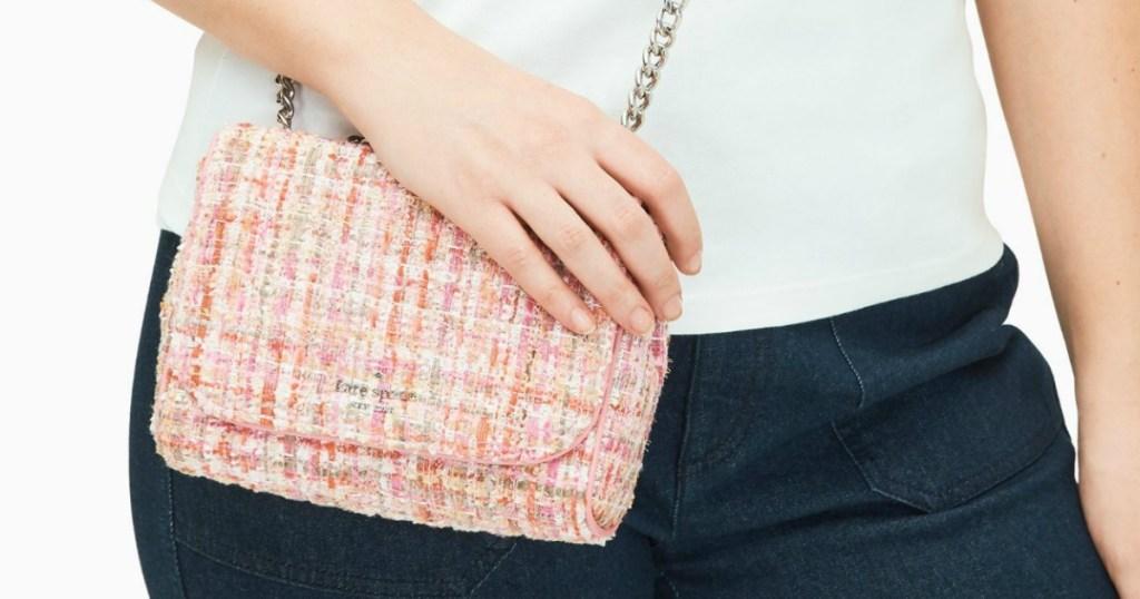 woman wearing a crossbody handbag