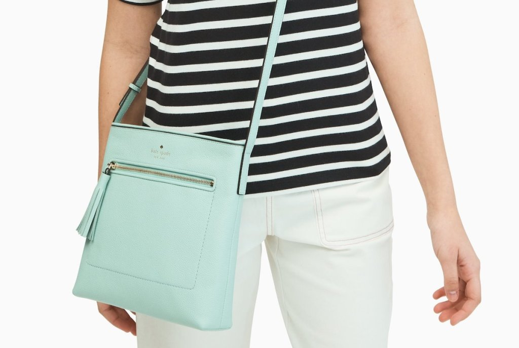 woman wearing a crossbody purse