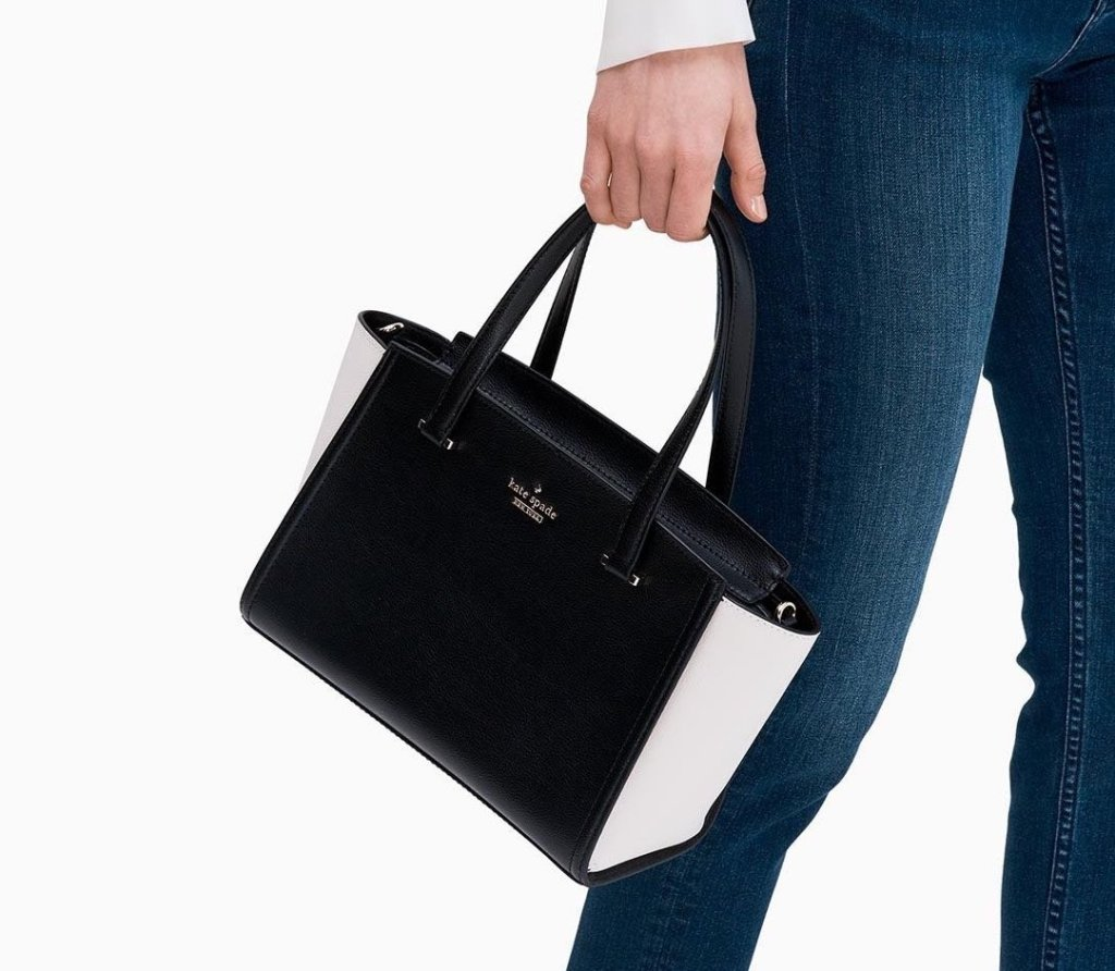 woman carrying a purse