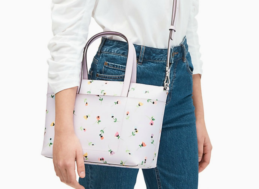 woman holding pink floral purse