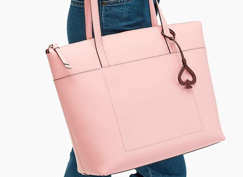 woman holding a large pink bag