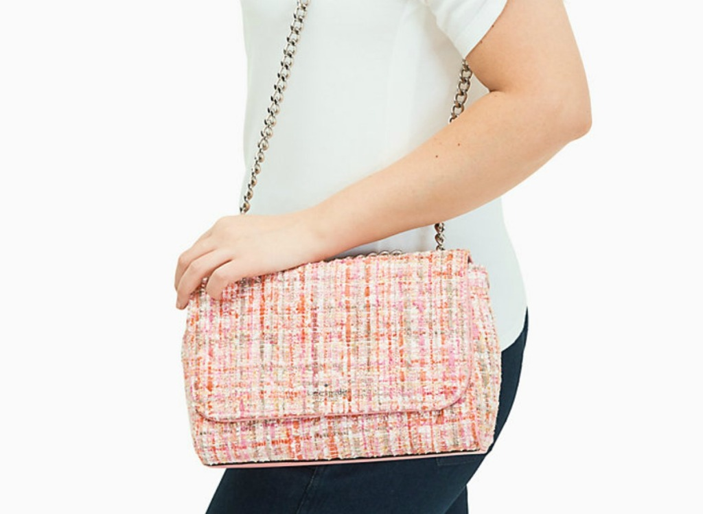 woman holding pink purse