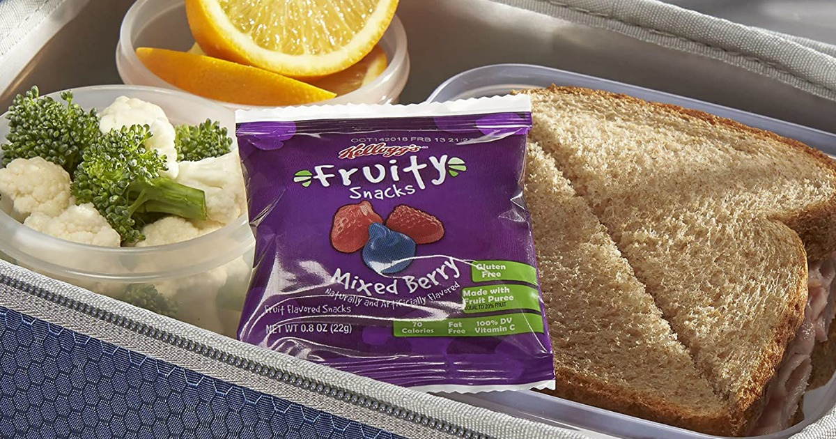 Kellogg's fruity snacks pack in lunchbox with sandwich, veggies and orange wedges