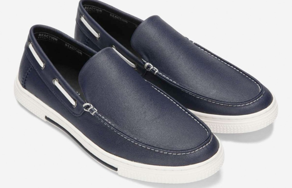 pair of mens navy leather slip-on boat shoes with white rubber soles