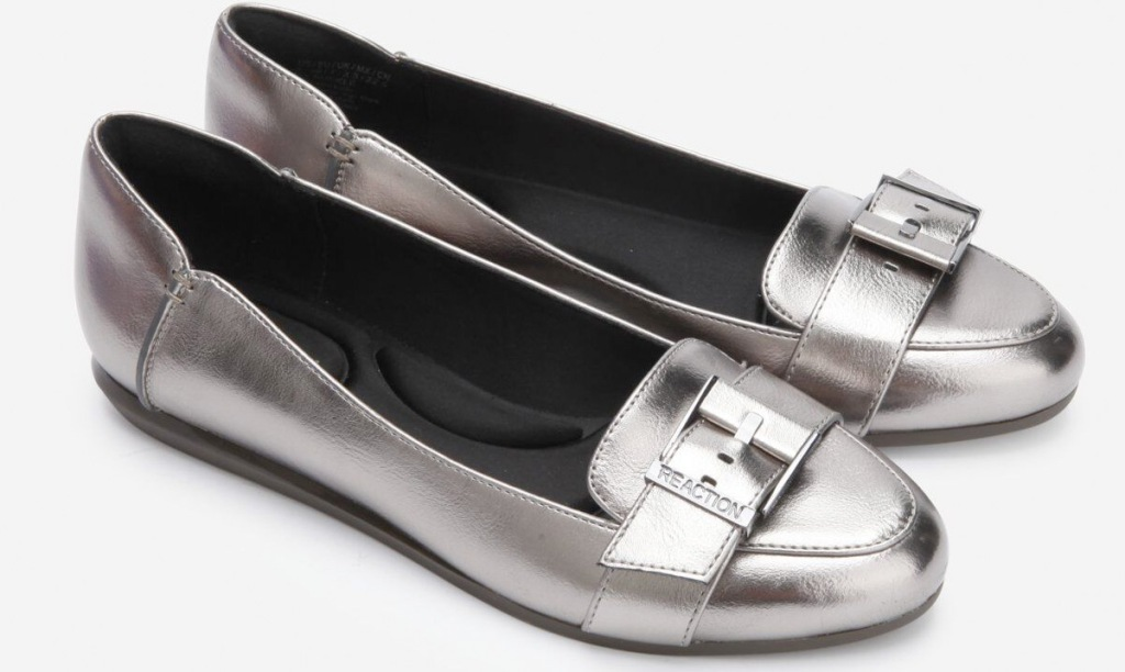 pair of silver womens flats with buckles across tops
