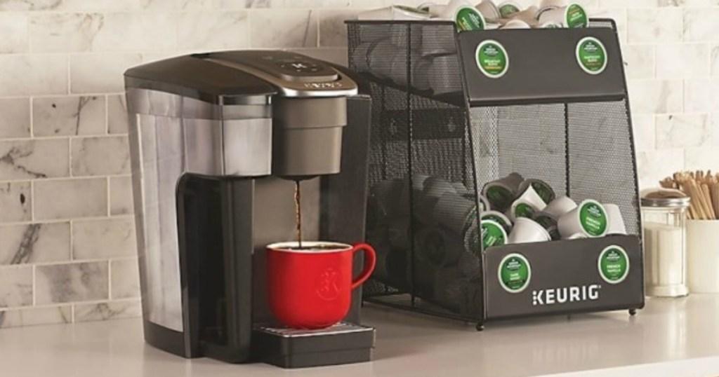 keurig coffee machine next to bin full of k-cups
