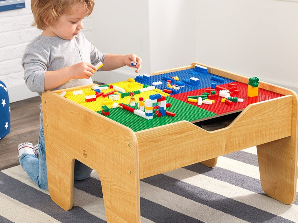 little boy playing at activity table