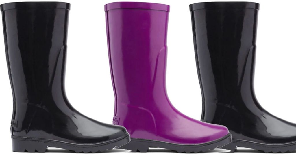 two black and one purple pair of kids columbia rain boots
