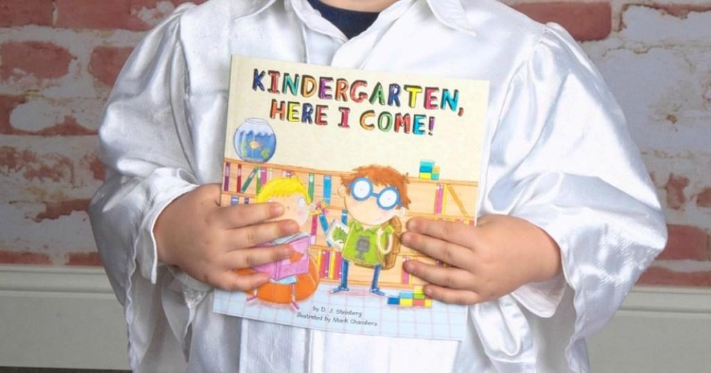 Kid holding Kindergarten Here I Come Book