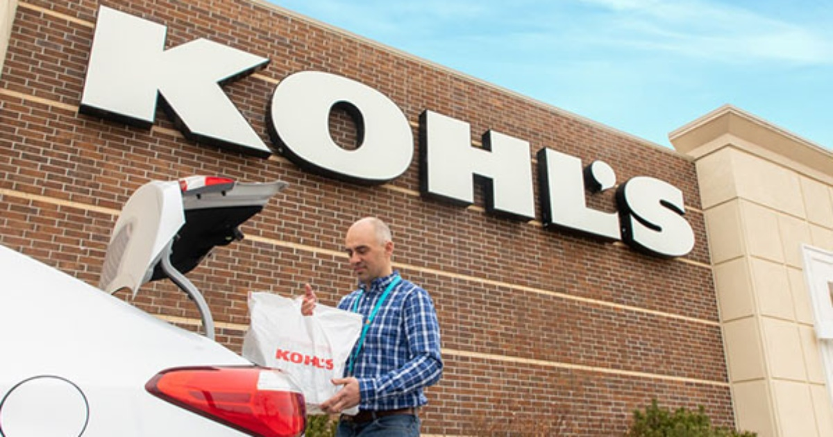 man putting bag into trunk outside of Kohl's