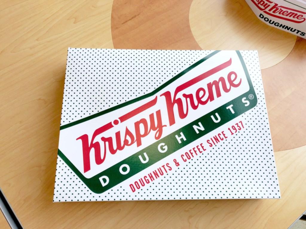 box of Krispy Kreme Doughnuts on table