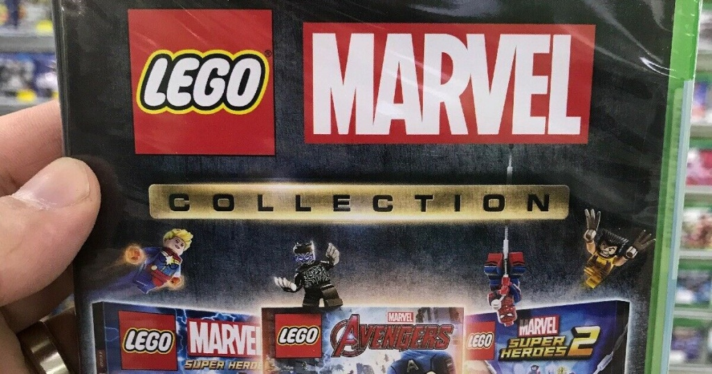 hand holding lego marvel video game in store